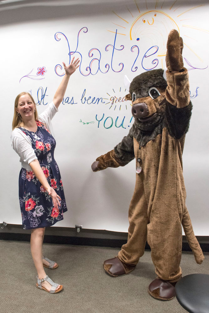 During her last week at Fermilab, Associate Director for Communications Katie Yurkewicz poses with the lab mascot. Photo: Reidar Hahn