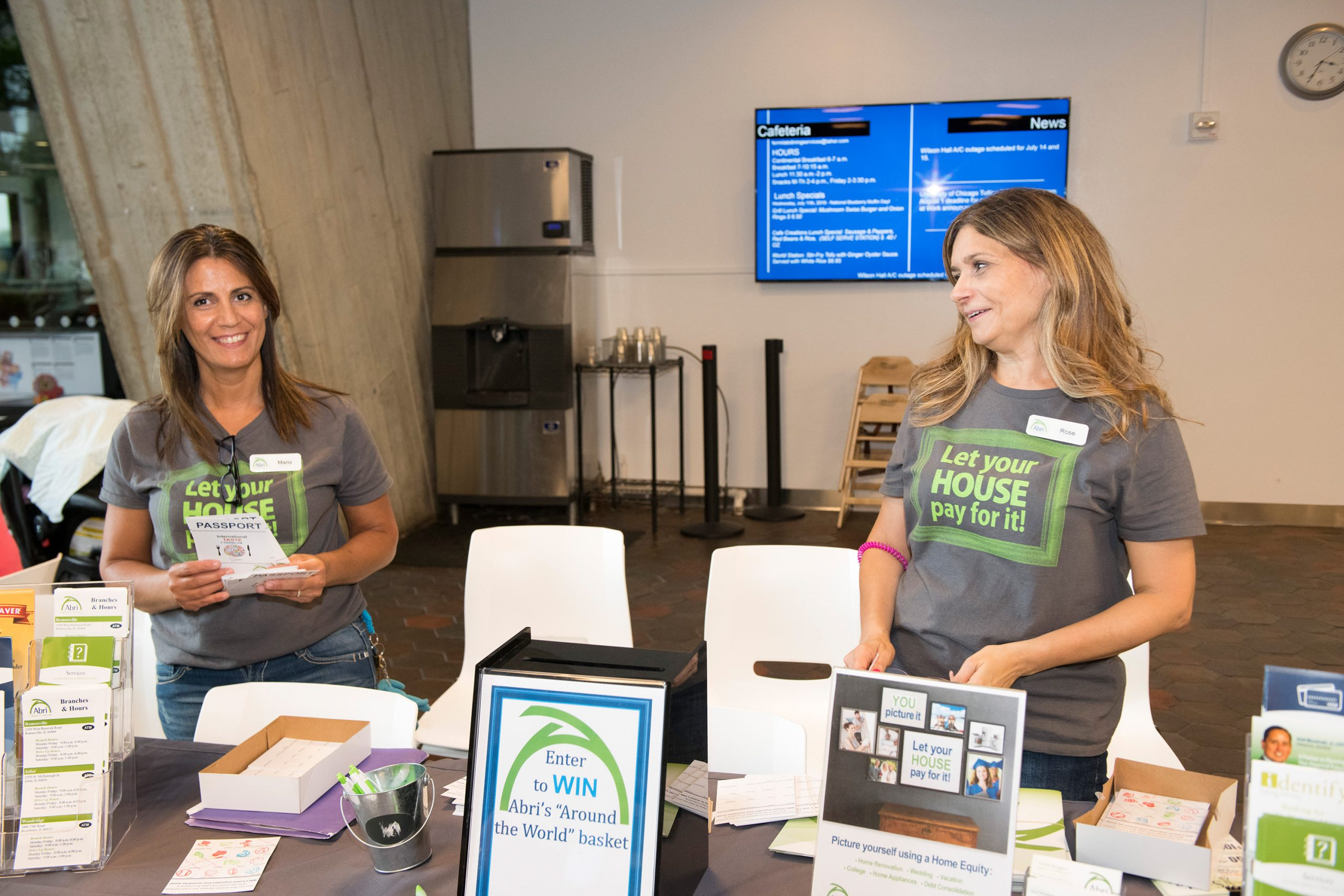 """Abri Credit Union partnered in the International Taste of Fermilab. They provided """"passports"""" for the event. Participants had their passports stamped at each table and returned them to Abri to enter the raffle. Photo: Reidar Hahn"""