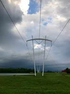 Signs of a storm approaching Fermilab are seen over the pi poles on Aug. 28. nature, landscape, pi poles, storm, sky, cloud Photo: Bridgett Pygott