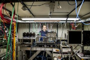 Artur Apresyan works on electronics and instrumentation in a beamline at Fermilab for the Large Hadron Collider's CMS detector. Photo: Reidar Hahn