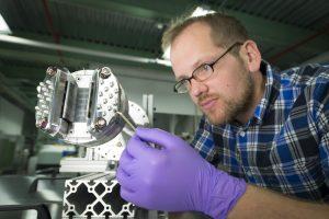 Curtis Baffes prepares the absorber prototype for installation. Photo: Reidar Hahn