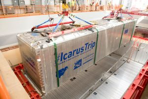 The first of two ICARUS detector modules is lowered into its place in the detector hall. Photo: Reidar Hahn