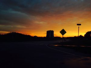 The sunset behind Wilson Hall casts the nearly all of the landscape in silhouette. sunset, landscape, Wilson Hall, building, sky, cloud, nature Photo: Emanuele Aucone