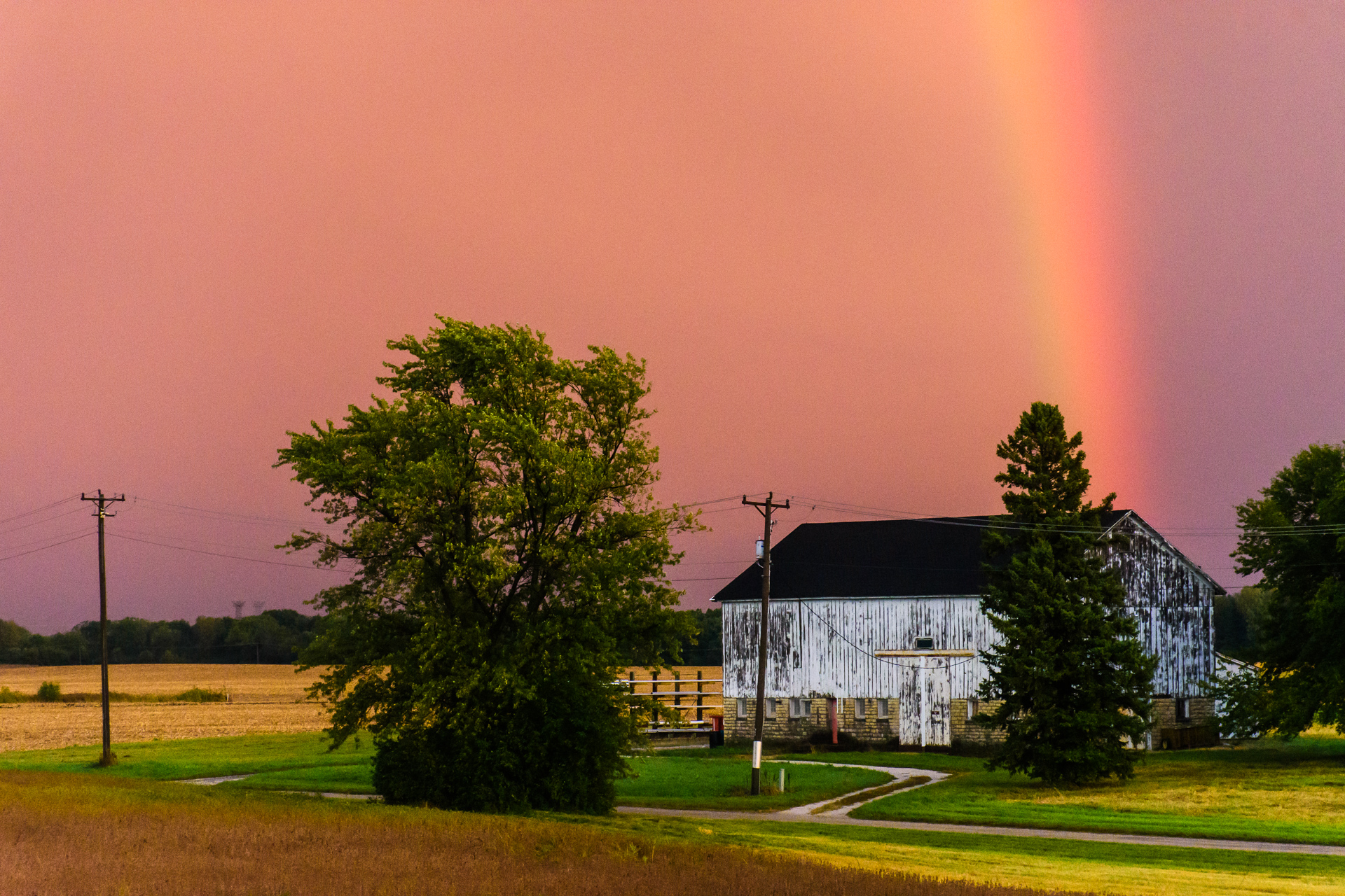 (1/2) A stunning, rainbowed sky sweeps over Site 67, as seen from the NML building, after a thunderstorm on Sept. 25. rainbow, sky, landscape, barn, building, thunderstorm, storm Photo: Giulio Stancari