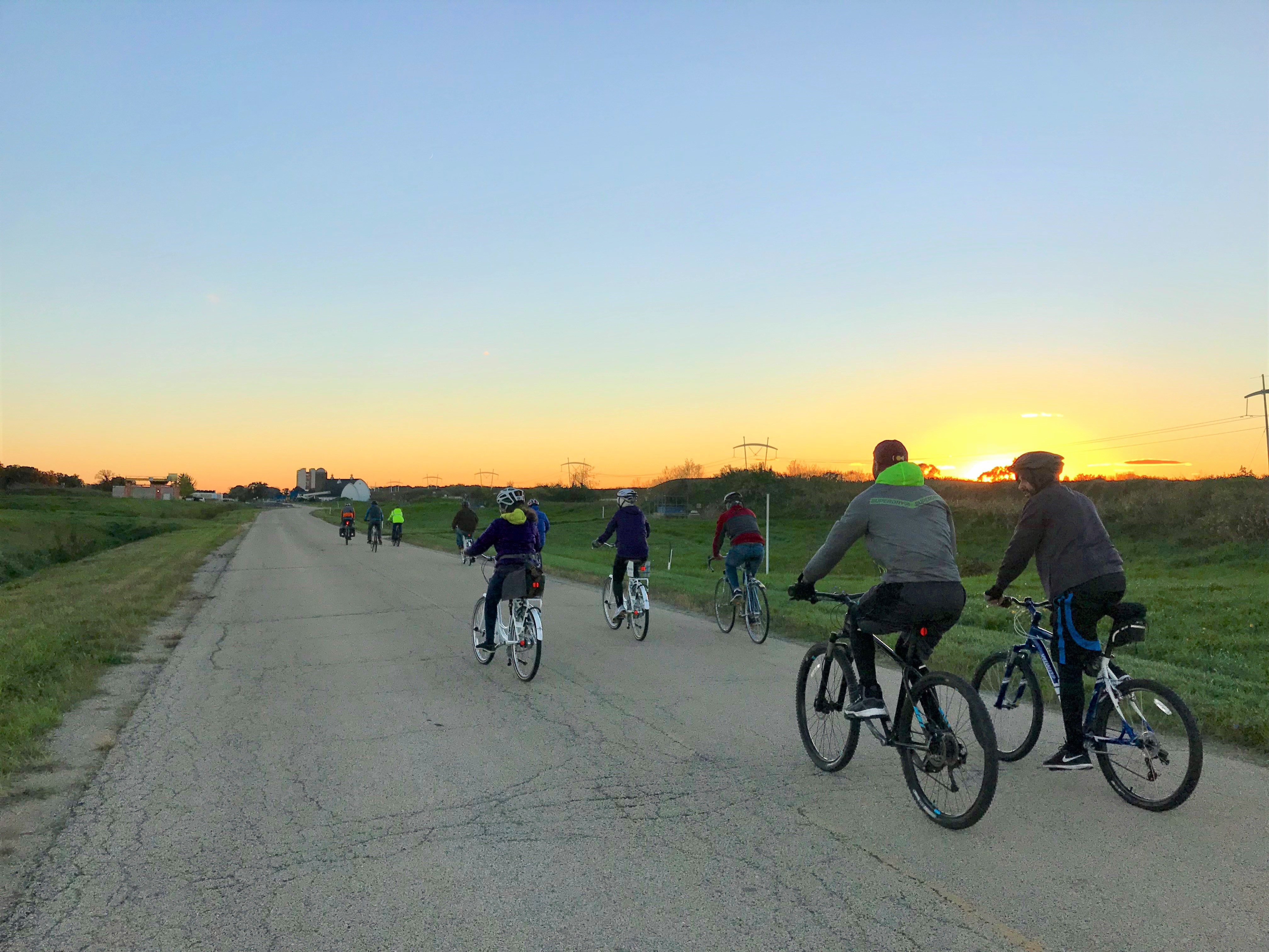 The Fermilab Young Professionals group enjoys a sunset bike ride through Fermilab on Oct. 11. people, lab life Photo: Hannah Ward