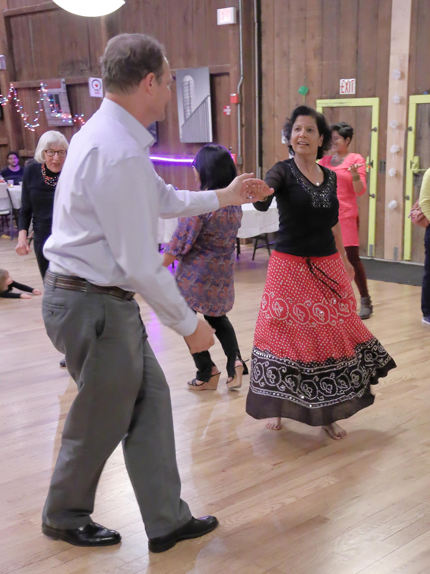 (1/2) Fermilab community members celebrated Diwali on Oct. 14. Dancing inside Kuhn Barn are Craig Drennan and Alpana Shenai. people, lab life, holiday Photo: Elliott McCrory