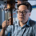 Aaron Chou works on an experiment that uses qubits to look for direct evidence of dark matter. Photo: Reidar Hahn