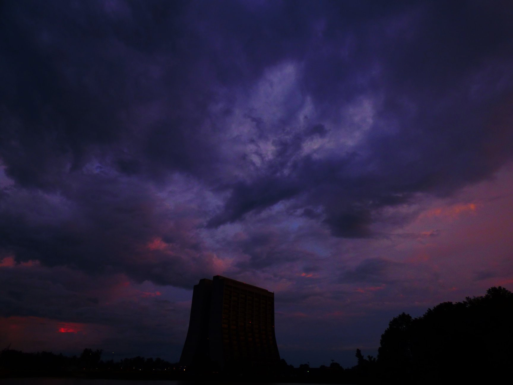 (1/2) Dramatic violet skies bear down on Wilson Hall. nature, landscape, cloud, sky, Wilson Hall, night Photo: Amy Scroggins