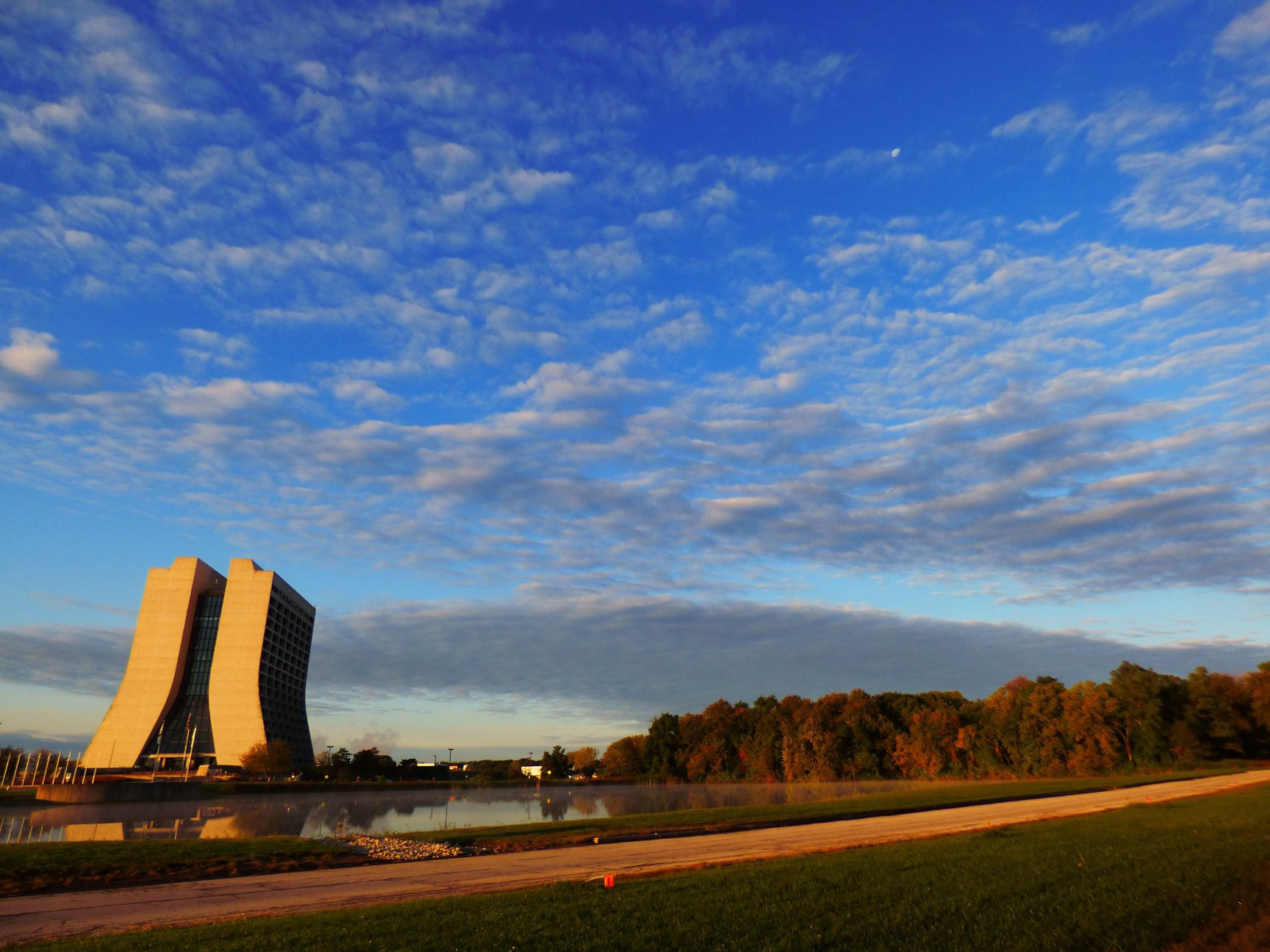 (1/3) Clouds dot a rich, blue sky over Wilson Hall ... Photo: Amy Scroggins