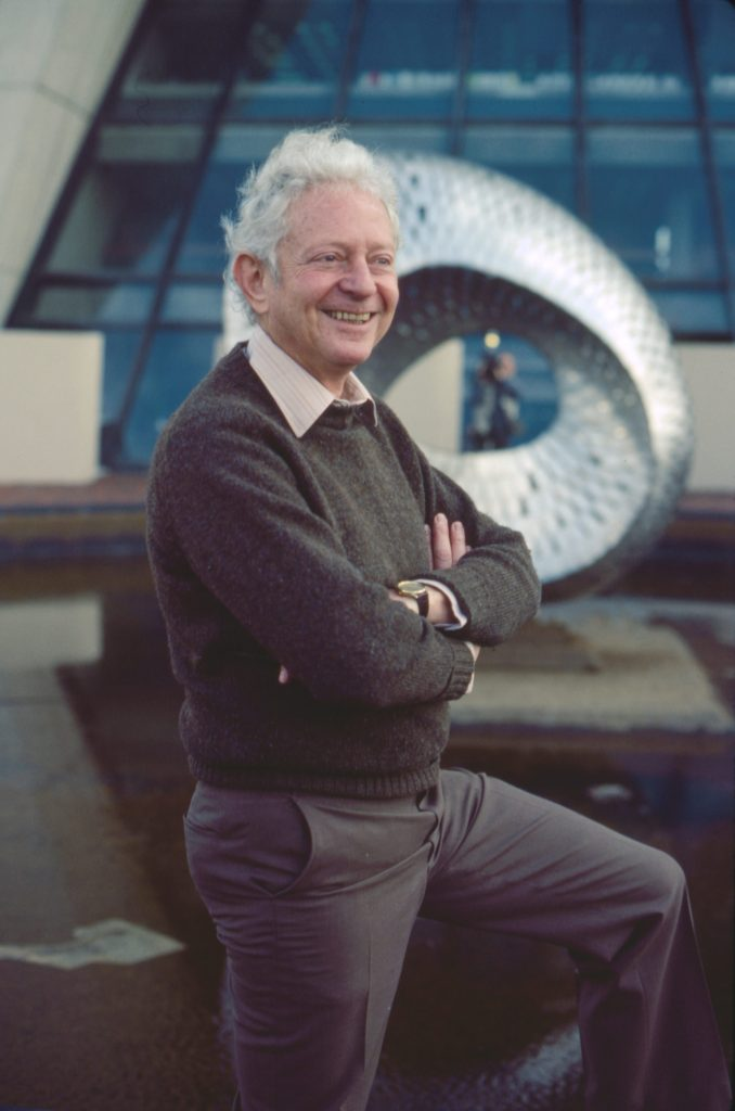 Leon Lederman stands outside Wilson Hall at Fermilab on the day he learned he was awarded the 1988 Nobel Prize.