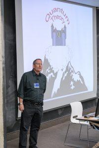 California Institute of Technology physicist John Preskill discusses advances in quantum information science at the workshop's colloquium. Photo: Reidar Hahn