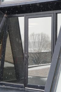(1/2) Nov. 15 brings reflections of snow from outside of Wilson Hall. nature, winter, landscape, snow, building, Wilson Hall Photo: Marguerite Tonjes