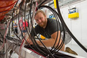 Erik Dopp is one of the first VetTech interns and now a full-time Fermilab employee. Photo: Reidar Hahn