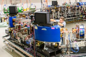 (2/2) Jamie Santucci works on one of the synchrotron-light diagnostic stations in the Fermilab Integrable Optics Test Accelerator, or IOTA. Photo: Giulio Stancari