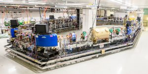 (1/2) After the first electron beam was circulated in August 2018, the experimental program at the Fermilab Integrable Optics Test Accelerator (IOTA) continues with commissioning of machine and diagnostics and with the first beam-physics experiments. This view of IOTA was taken in November 2018. people, accelerator, IOTA Photo: Giulio Stancari