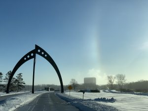 (1/2) It's a beautiful morning, despite the freezing temperatures. The photo was taken on Jan. 31. sundog, winter, sculpture, Broken Symetry, landscape, nature, building, Wilson Hall, sky Photo: Rick Ford