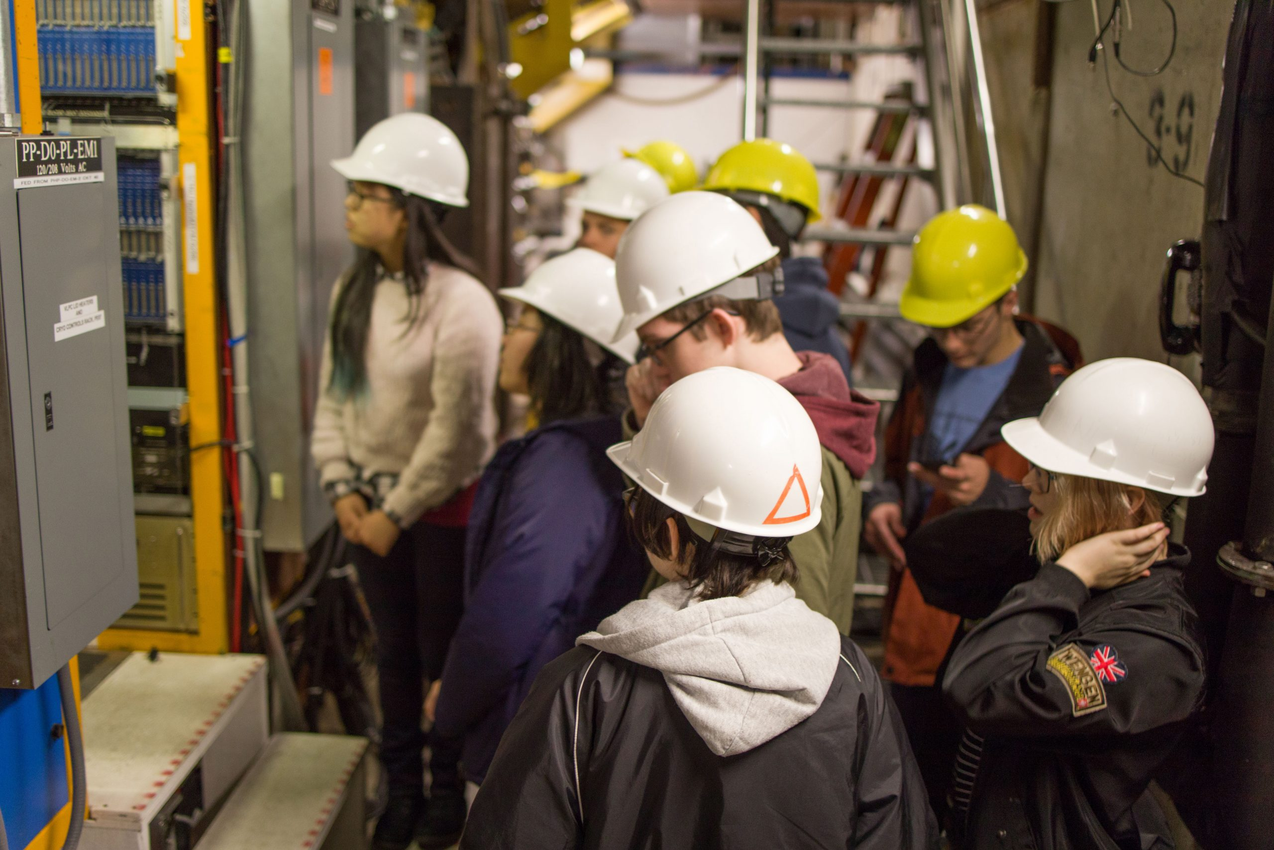 IMSA students on the ground floor of DZero on Nov. 26, 2018. This continues to be one of the best tours at Fermilab. George Ginther and Stefan Gruenendahl always need tour guides. If you want to help with these tours, contact them for details on how to get involved. It is a ton of fun. people, DZero Photo: Elliott McCrory