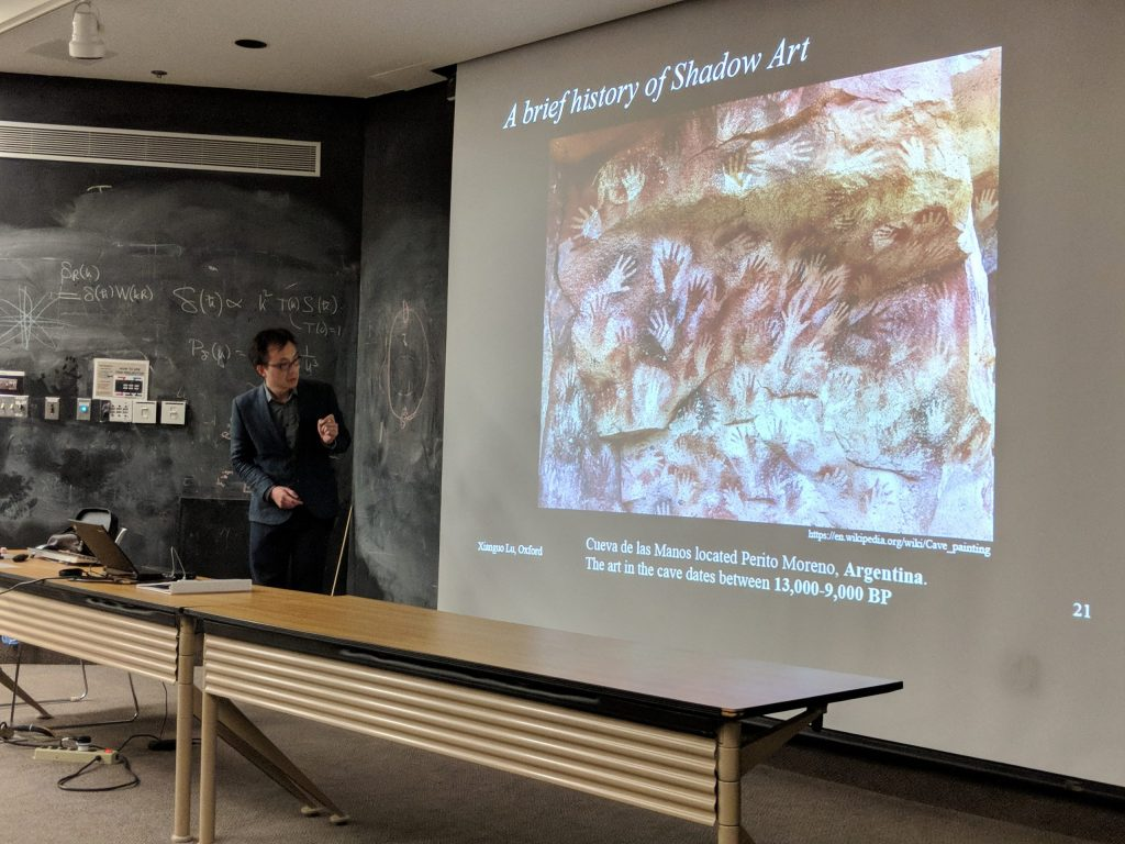 Xianguo Lu from University of Oxford explains why neutrinos leave no shadows at the March 2, 2018 Fermilab Wine & Cheese Seminar. Photo: Kevin McFarland