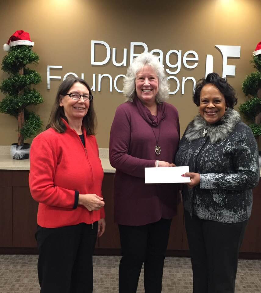 Dupage Foundation's Dianne Engram presents the $12,000 grant to FNA Vice President Liz Copeland, with FNA President Penny Kasper. Photo courtesy of Liz Copeland