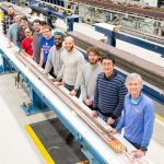 Fermilab engineers and technicians stand by a magnet coil made for the High-Luminosity LHC. Photo: Reidar Hahn