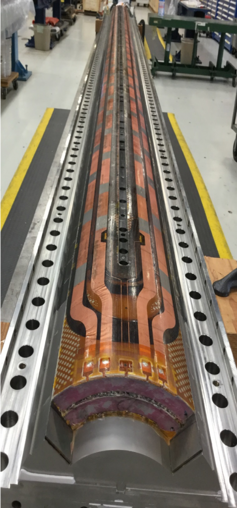 This completed niobium-tin magnet coil will generate a maximum magnetic field of 12 tesla, roughly 50 percent more than the niobium-titanium magnets currently in the LHC. Photo: Alfred Nobrega