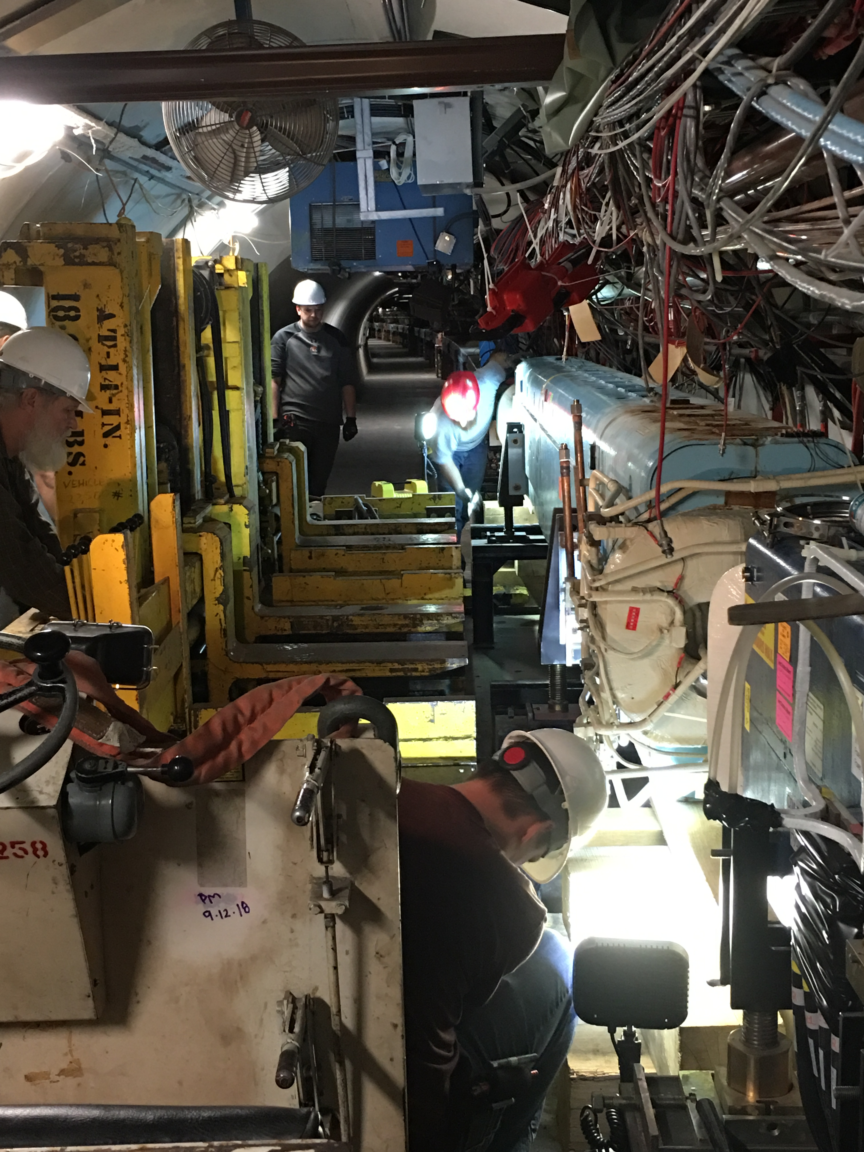 (1/3) On March 6, a 30,000-pound B3 magnet was changed out in the F17 area. people, accelerator, magnet Photo: Christine Ader