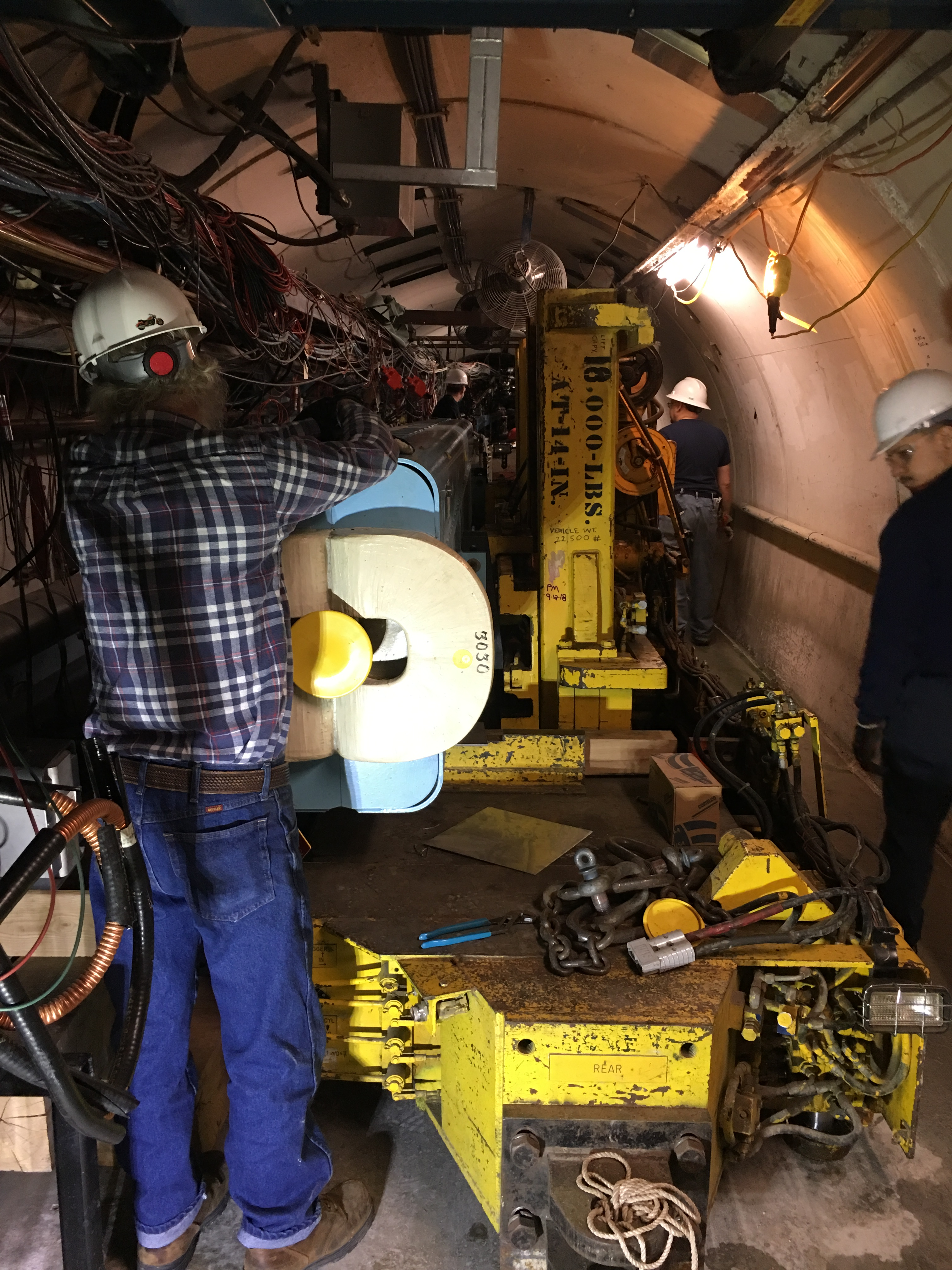 (2/3) The old magnet had failed, and the magnet mover was used to remove it and install the new magnet. accelerator, magnet, people Photo: Christine Ader