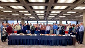 On March 13, longtime Fermilab scientist Rob Roser said farewell to friends and colleagues at a going-away celebration. There was quite a spread. people Photo: Marty Murphy