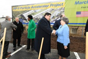 After the groundbreaking, Governor JB Pritzker, center, shakes the hand of Fermilab's Lia Merminga, PIP-II project director. Photo: Reidar Hahn
