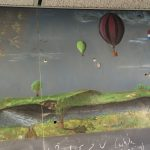 """This chalkboard drawing is located in WH14NW, and the only identifying mark is """"JM 78"""". While the formulas and diagrams around this drawing change regularly, this beautiful picture of a balloon rally has remained untouched for over 40 years! Drawing: JM. Photo: Jamieson Olsen"""