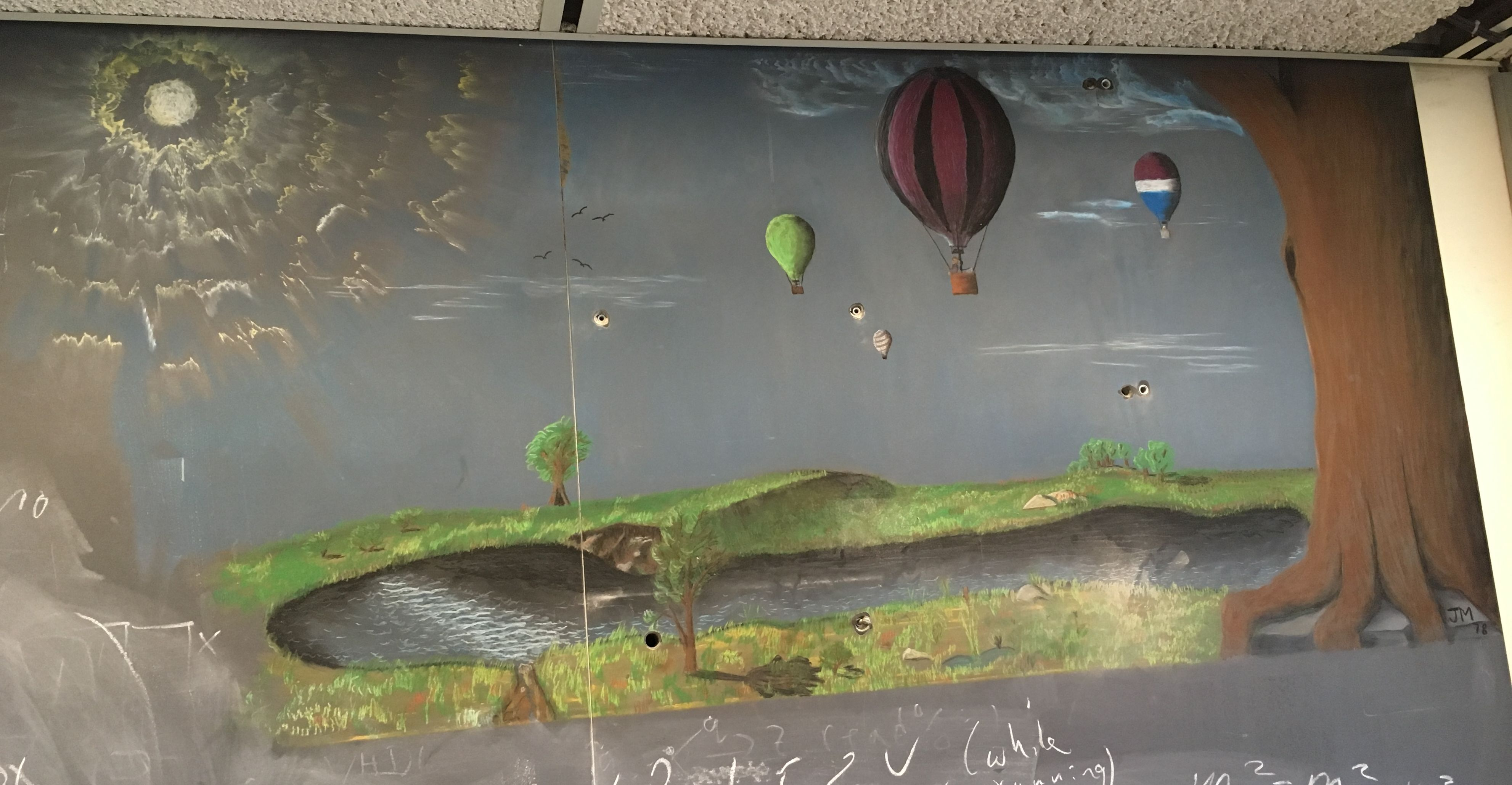 "This chalkboard drawing is located in WH14NW, and the only identifying mark is ""JM 78"". While the formulas and diagrams around this drawing change regularly, this beautiful picture of a balloon rally has remained untouched for over 40 years! Drawing: JM. Photo: Jamieson Olsen"