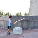 Antonio smacks a garbage bag made into a ball with a balloon sword that he received atthe Mr. Freeze show he attended at DASTOW, which took place during the Earth Day Fair. people, lab life, DASTOW Photo: Leticia Shaddix