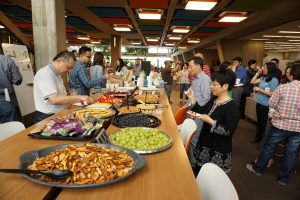 The Asian and Pacific American community at Fermilab gathers to eat and talk at the group's first meet-and-greet. Photo: Alex Chen