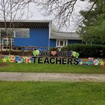 "(1/2) On Tuesday, May 7, some kind individuals posted ""We Love our Teachers"" signs in front of the Fermilab Children's Center in the Village. everyday objects, lab life Photo: Julius Borchert"