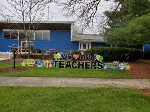 """(1/2) On Tuesday, May 7, some kind individuals posted """"We Love our Teachers"""" signs in front of the Fermilab Children's Center in the Village. everyday objects, lab life Photo: Julius Borchert"""