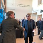 Fermilab's Tom Kroc, left, welcomes U.S. Energy Secretary Rick Perry to the Fermilab booth. Photo: Aaron Sauers