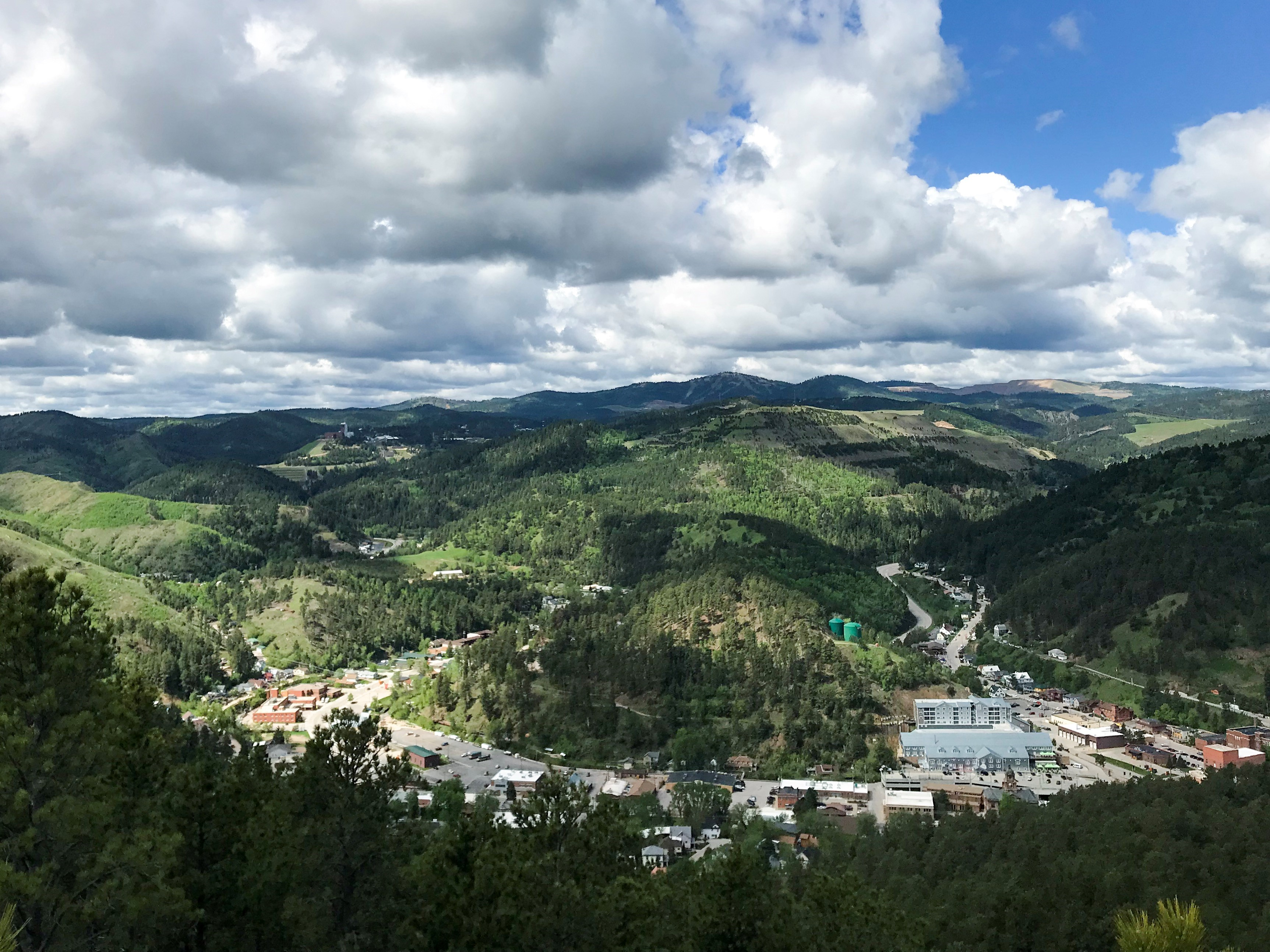 (2/3) This is a view of the Yates complex from the top of White Rocks in Deadwood, South Dakota. South Dakota, landscape, nature, Sanford Lab, Sanford Underground Research Facility, cloud, sky, mountain Photo: Bridgett Pygott