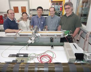 Sali Sylejmani, on the left end, is shown with a prototype straw chamber. He was a member of the Particle Physics Division in 2002. Photo: Reidar Hahn