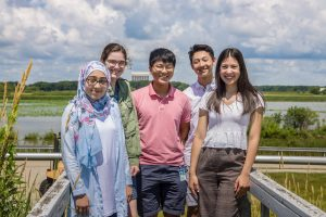 The 2019 QuarkNet interns at Fermilab stand near the stairway over the Main Ring at DZero. From left: Kiana Mohammadian, Hailey Hurd, Eric Chen, Alexander Jang, Molly Wehrenberg. people Photo: Elliott McCrory