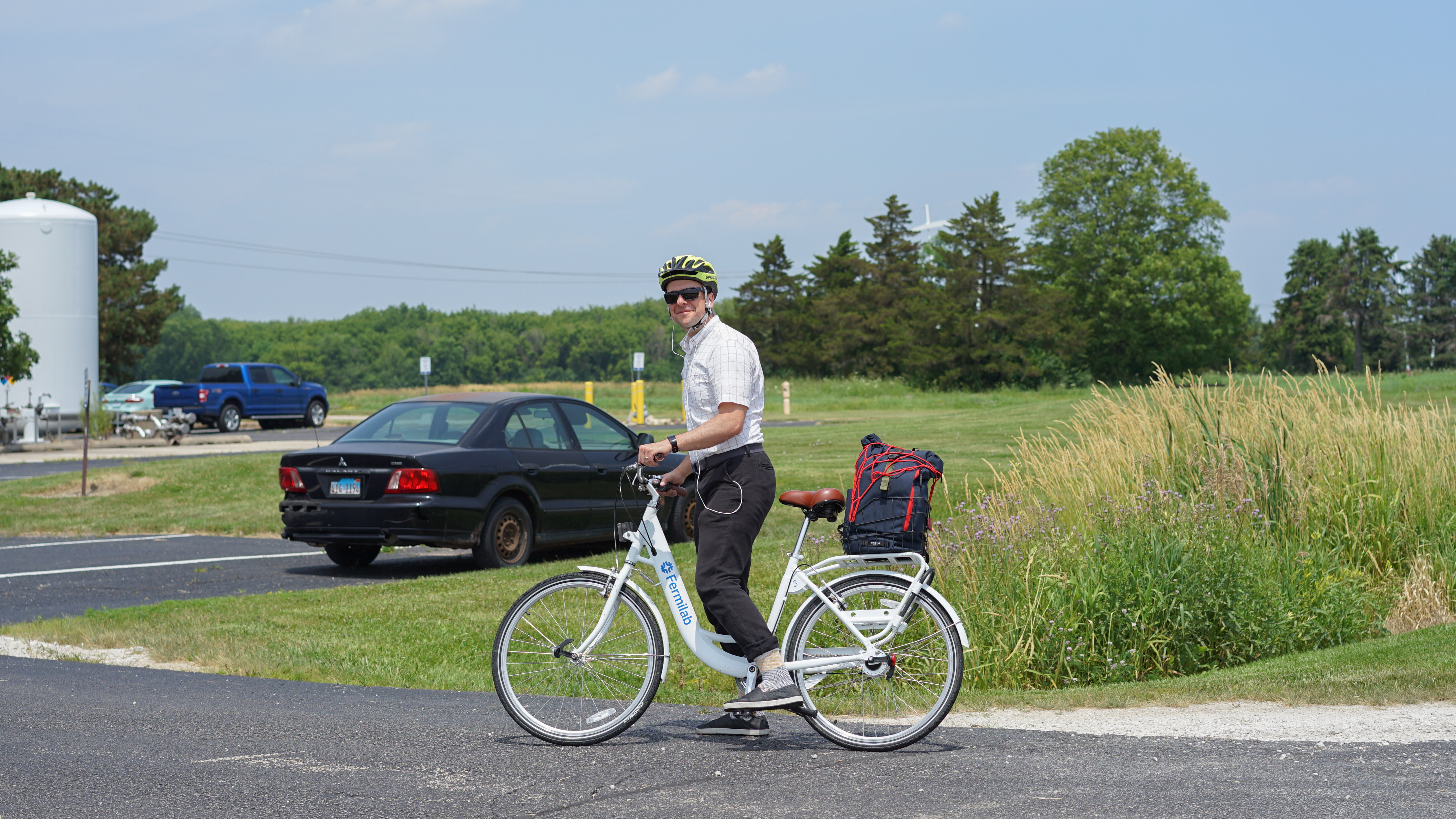 Daniel Bowring enjoys one of the bicycles from the Fermilab bike share program as he returns to work at SiDet. people Photo: Leticia Shaddix
