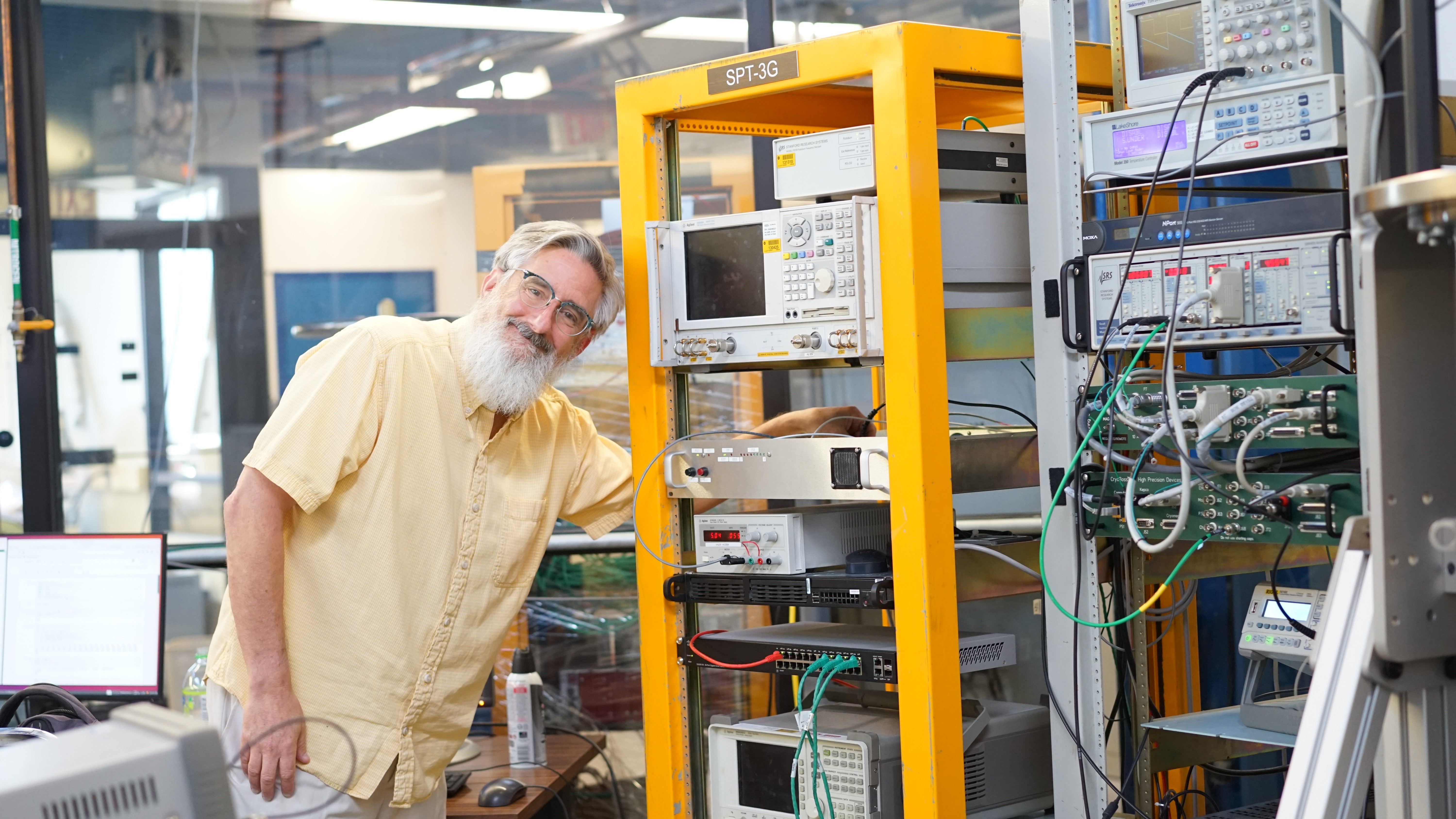 (2/2) The electronics is Gustavo Cancelo's fMESSI board (for frequency multiplexed electronics for superconducting sensors), which they use to control the uMUX (microwave multiplex) chip from NIST. Chris enjoys his work! people Photo: Leticia Shaddix