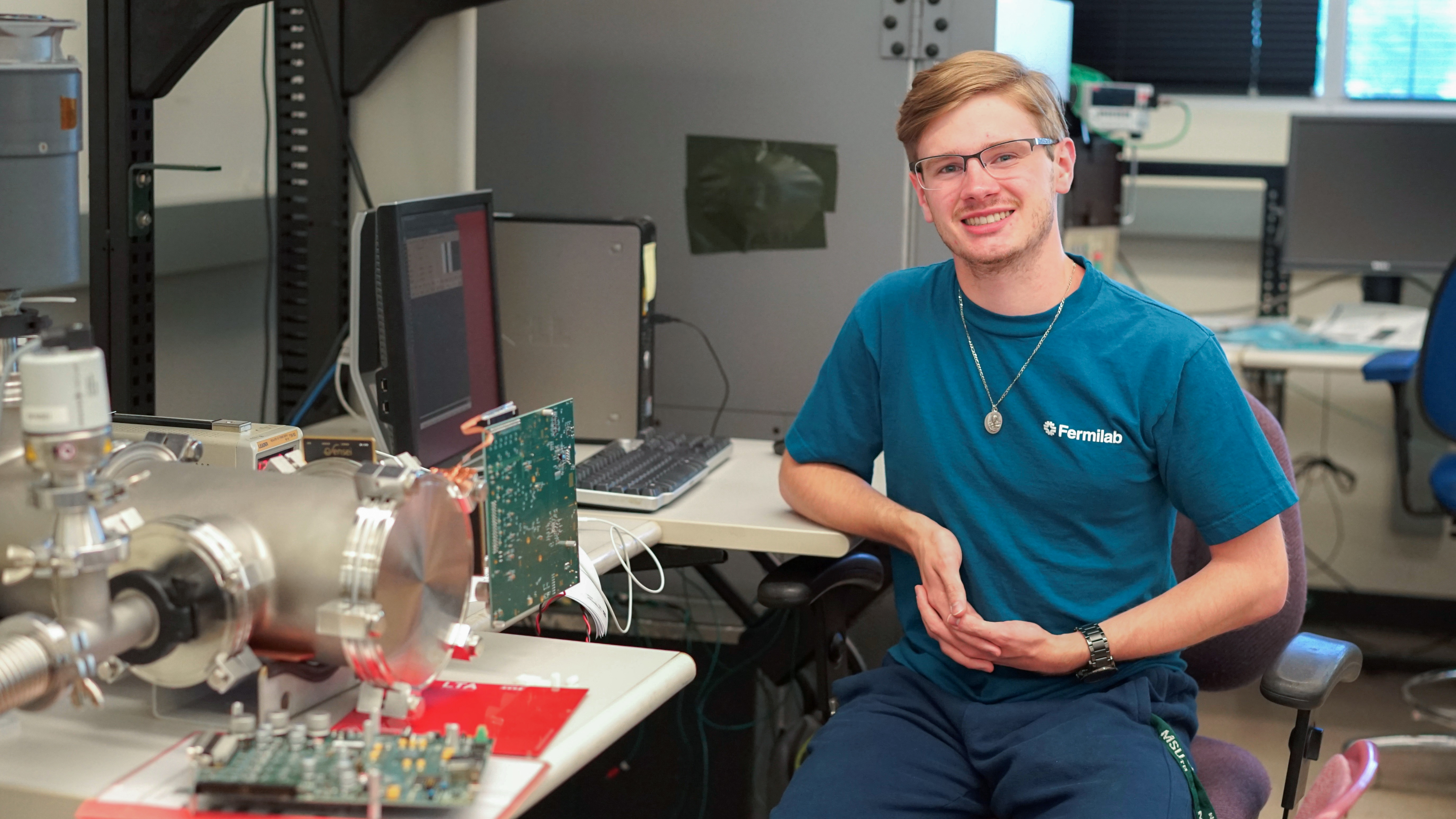 (1/4) Dylan Smith is a research intern under scientist Erik Ramberg. He hails from Dearborn, Michigan, and is currently a senior at Michigan State University. In the test room at SiDet, there is a vacuum chamber with a charge-coupled device (CCD) coated in boron-10. His research goal is to characterize ultracold neutron events that occur when the neutrons hit the boron-10 and come into contact with the CCD. He's also been working with software that simulates particle tracks in silicon, with the eventual goal of designing a method to calculate the incident angle of alpha particles that hit a silicon target. people Photo: Leticia Shaddix