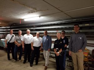 Cons Gattuso, second from right, gives a tour of the Muon Delivery Ring to local law enforcement and Fermilab Fire Department personnel on July 16. people Photo: Lori Limberg