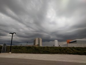 A storm brews over the Muon Campus on July 18. nature, landscape, storm, cloud, sky, building, Wilson Hall Photo: Mark Dilday