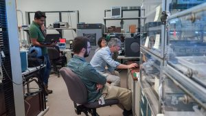 (1/4) Maral Alyari and Zoltan Gecse, both from CMS, are teaching detector upgrade HATS @ LPC. At Zoltan's station, students are studying leakage current as a function of bias voltage at different temperatures on the six-inch HGCal silicon modules. people Photo: Leticia Shaddix.