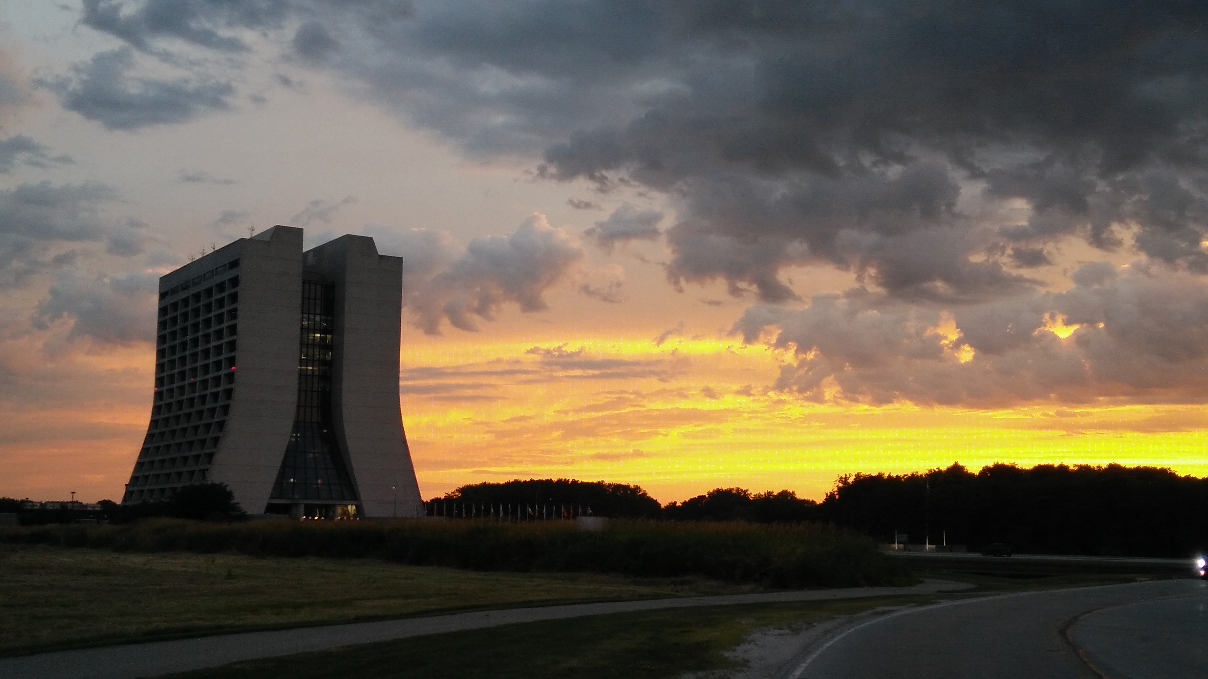 (1/4) Golden July sky covers the Fermilab site. nature, landscape, building, Wilson Hall, cloud, sky, sunset Photo: Piyush Jain