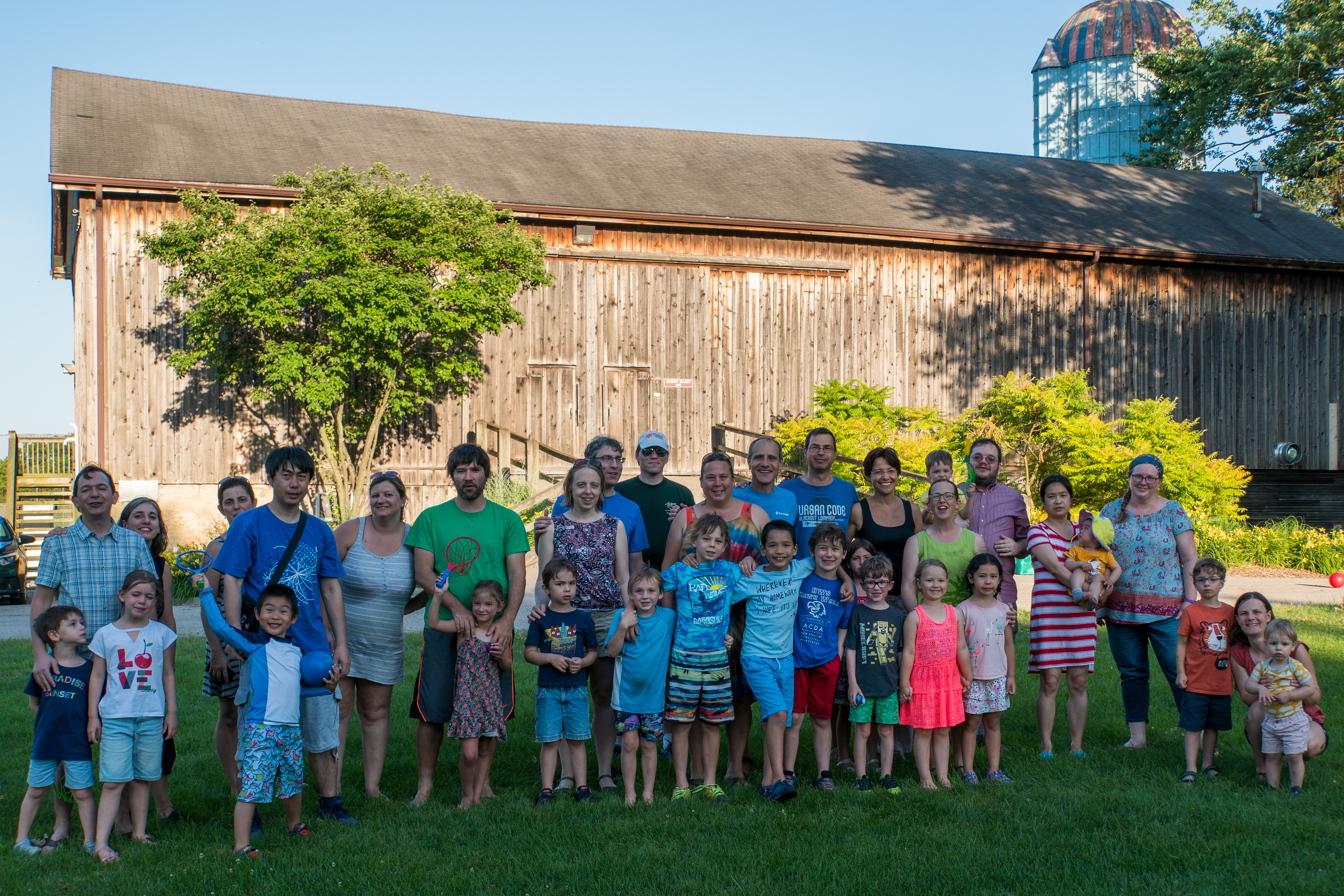 """Families get together for a potluck meal and outside fun after a discounted swim at the Fermilab pool as part of Fermilab's playgroup on a recent Wednesday. To find out more, visit <a href=""""https://get-connected.fnal.gov/playgroup/"""">https://get-connected.fnal.gov/playgroup/</a>. people, lab life Photo: Marguerite Tonjes"""