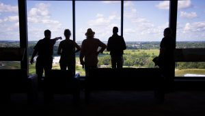 Andre Salles points to the future of Fermilab during a tour on the 15th floor of Wilson Hall. people Photo: Elliott McCrory