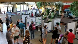 (1/6) Students and lecturers mingle in the Wilson Hall atrium during one of the poster sessions of the International Neutrino Summer School at Fermilab. people Photo: Kurt Riesselmann