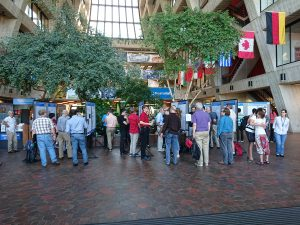 (1/4) At the end of their internship, Fermilab summer students present their work at a poster session in Wilson Hall on Aug. 8, 2019. people Photo: Giulio Stancari